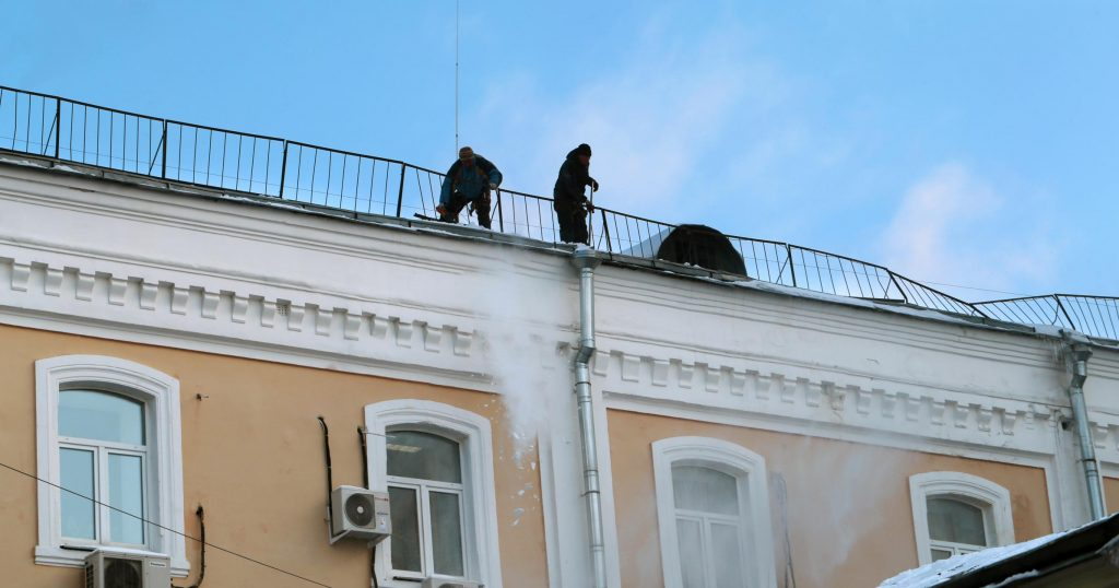 men are working on the roof