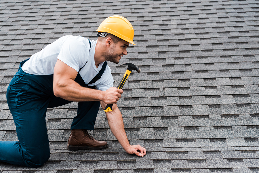 man drives the nails on the roof