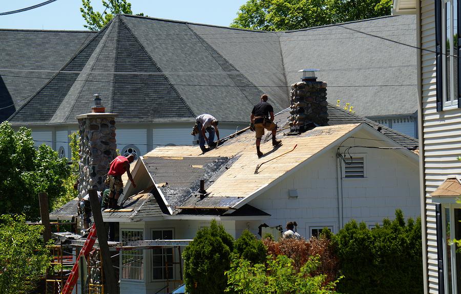 men are repairing the roof
